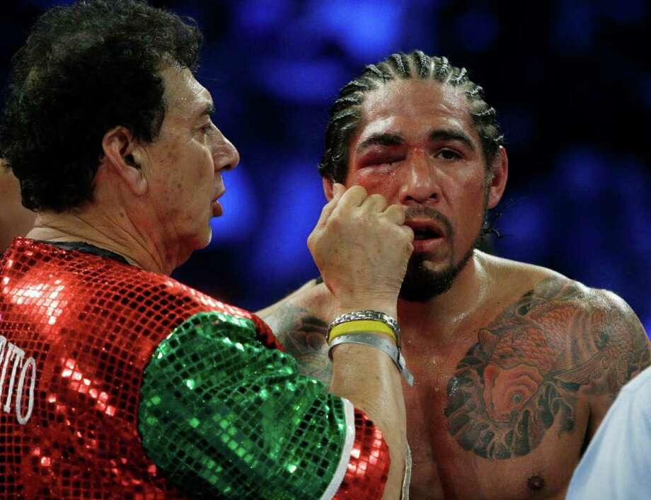 Antonio Margarito has his eye worked on after the ninth round Saturday. He didn't fight a 10th round. Photo: AP
