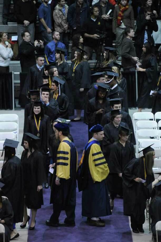 Graduates proceed to their seats at the  SEFCU Arena during the UAlbany Winter Commencement  on Sunday Dec. 4, 2011 in Albany, NY. (Philip Kamrass / Times Union ) Photo: Philip Kamrass / 00015597A