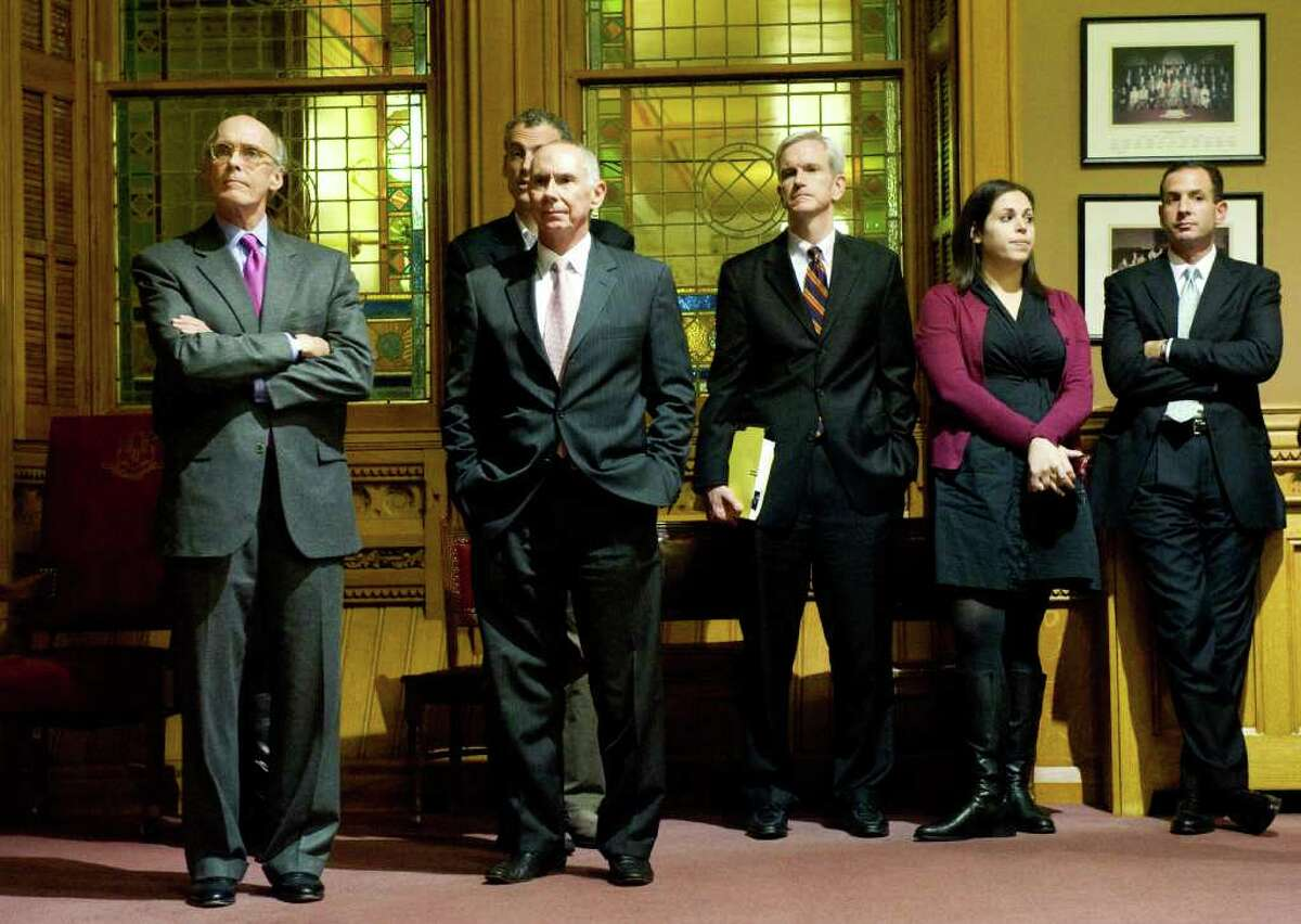 Gov. Dan Malloy's team from left, Chief of Staff Tim Bannon, Deputy Secretary of Office of Policy Management Mark Ojakian, Legal Counsel Andrew McDonald, Director of Inter-Governmental Affairs Arielle Reich and Senior Advisor Roy Occhiogrosso watch during a televised signing of the jobs bill in Hartford, Conn., October 27, 2011.