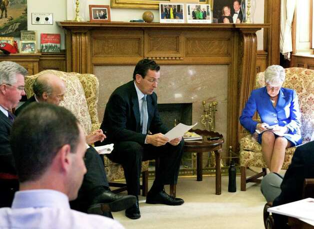 Gov. Dan Malloy and Lt. Gov. Nancy Wyman meet with legislators in the Governor's office at the state Capitol in Hartford, Conn. on Oct. 25, 2011. Photo: Keelin Daly / Stamford Advocate