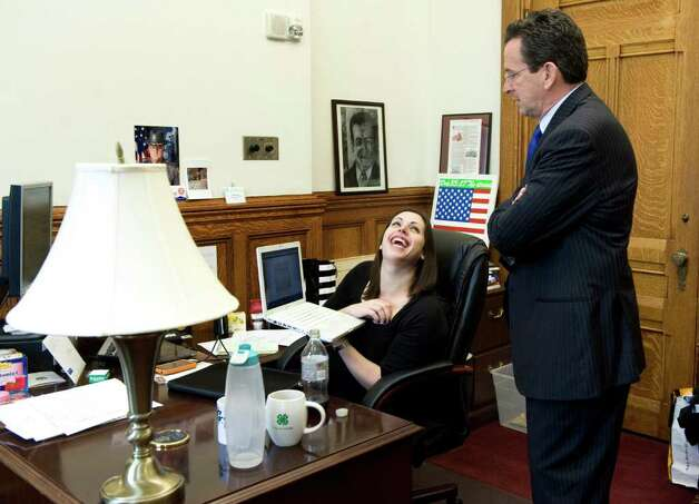 Gov. Dannel P. Malloy shares a laugh with Arielle Reich, Director of Intergovernmental Affairs, at the state Capitol in Hartford, Conn. on Tuesday May 17, 2011. Photo: Kathleen O'Rourke / Stamford Advocate