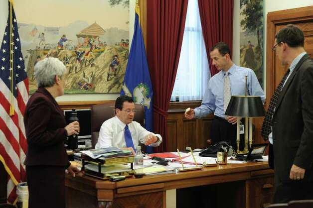 Gov. Dan Malloy meets with Lt. Gov. Nancy Wyman, Roy Occhiogrosso and Ben Barnes at the state Capitol in Hartford, Conn. on Wednesday May 18, 2011. Photo: Kathleen O'Rourke / Stamford Advocate