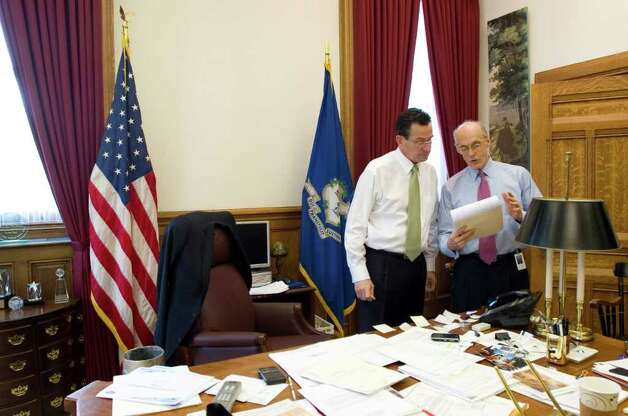 Gov. Dan. Malloy meets with his chief of staff, Tim Bannon before presenting his budget address to a joint session of the General Assembly in Hartford, Conn. on Wednesday, Feb. 16, 2011. Photo: Kathleen O'Rourke / Stamford Advocate