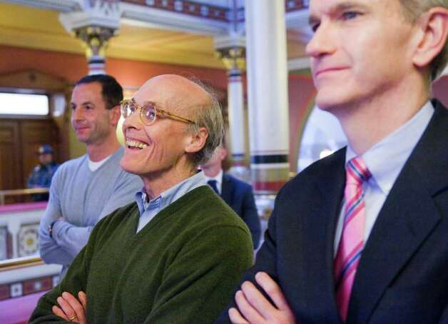 Gov. Dan Malloy's Chief of Staff Tim Bannon, center, listens along with Senior Advisor Roy Occhiogrosso, left, and Legal Counsel Andrew McDonald as the governor announces Bannon's resignation at the state Capitol in Hartford, Conn., November 1, 2011. Photo: Keelin Daly / Stamford Advocate