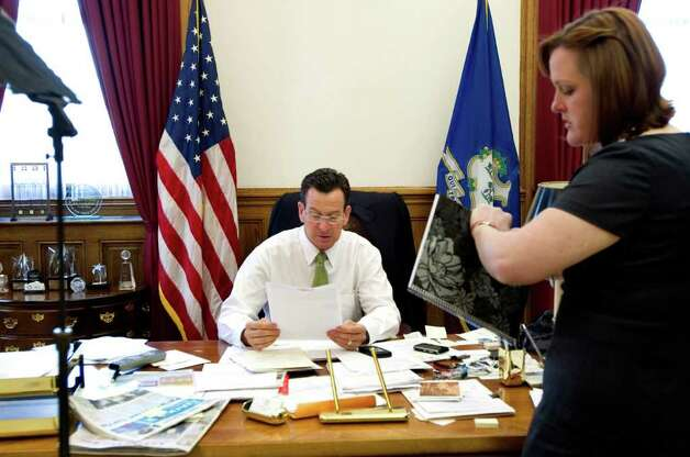 Gov. Dan Malloy and Director of Communications Colleen Flanagan. spend time in the governor's office on the morning of the budget address to a joint session of the General Assembly in Hartford, Conn. on Wednesday, Feb. 16, 2011. Photo: Kathleen O'Rourke / Stamford Advocate