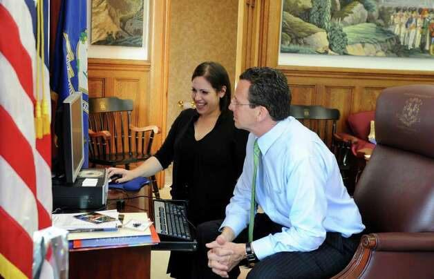 Arielle Reich works on the computer with Gov. Dan  Malloy in his office at the state Capitol in Hartford, Conn. on Wednesday June 8, 2011, the final day of the regular legislative session. Photo: Kathleen O'Rourke / Stamford Advocate