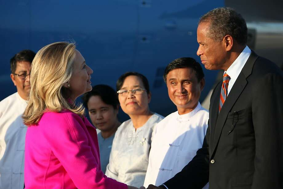 NAYPYITAW, MYANMAR - NOVEMBER 30:  In this photo provided by the U.S. State Department, U.S. Secretary of State Hillary Clinton is greeted by the U.S. Embassy in Myanmar Charge d'Affaires Michael Thurston as she arrives November 30, 2011 in Naypyidaw, Myanmar. Prior to traveling to Myanmar Clinton was in South Korea attending the Forum on Aid Effectiveness, focuing on fighting extreme poverty and improving gender equality.  (Photo by U.S. State Department via Getty Images) Photo: Handout, Getty Images