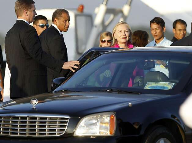 U.S. Secretary of State Hillary Rodham Clinton, center, gets on a car after her arrival at the airport in Naypyitaw, Myanmar, Wednesday, Nov. 30, 2011. Clinton has arrived in Myanmar on a historic visit to the long-isolated Southeast Asian nation to test the new government's commitment to reform, including severing military and nuclear ties with North Korea. (AP Photo/Vincent Thian) Photo: Vincent Thian, AP