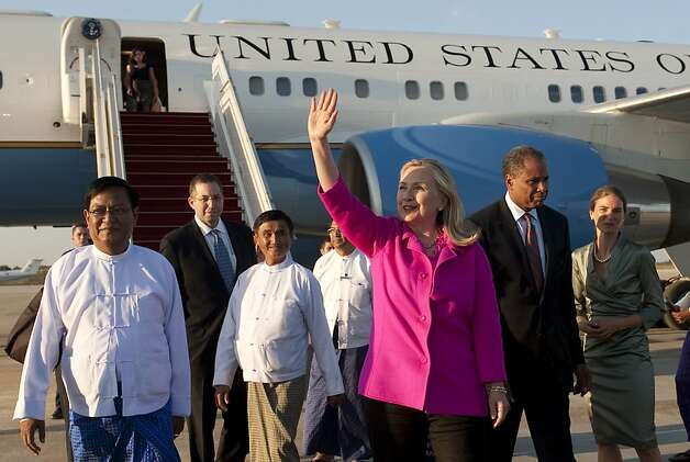 US Secretary of State Hillary Rodham Clinton waves alongside Myanmar Deputy Foreign Minister Myo Myint, left, upon her arrival by her airplane in Naypyidaw, Myanmar, Wednesday, Nov. 30, 2011. Making a diplomatically risky trip to the long-isolated Southeast Asian nation of Myanmar, Clinton said she wanted to see for herself whether new civilian leaders are truly ready to throw off 50 years of military dictatorship _ a test that includes rare face-to-face meetings with former members of the junta whose brutal rule made a poor pariah state of one of the region's most resource-rich nations. (AP Photo/Saul Loeb, Pool) Ran on: 12-01-2011 U.S. Secretary of State Hillary Rodham Clinton waves alongside Burma Deputy Foreign Minister Myo Myint (left). Ran on: 12-01-2011 U.S. Secretary of State Hillary Rodham Clinton waves alongside Burma Deputy Foreign Minister Myo Myint (left). Photo: Saul Loeb, AP