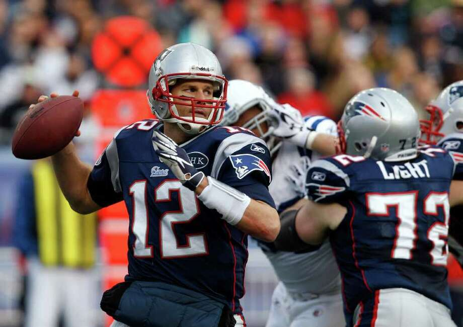 New England Patriots quarterback Tom Brady (12) looks looks for a receiver during the first quarter of the Patriots' NFL football game against the Indianapolis Colts in Foxborough, Mass., Sunday, Dec. 4, 2011. (AP Photo/Charles Krupa) Photo: Charles Krupa