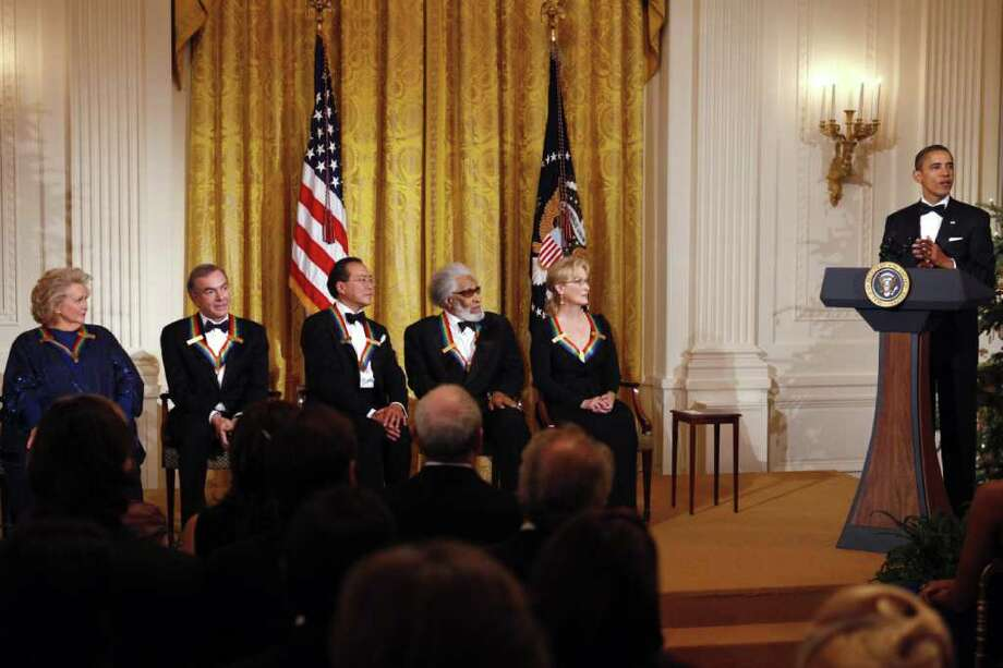 President Barack Obama, right, delivers remarks at a reception for the recipients of the 2011 Kennedy Center Honors, from left, singer Barbara Cook, singer and songwriter Neil Diamond, cellist Yo-Yo Ma, saxophonist and composer Sonny Rollins, and actress Meryl Streep,  in the East Room of the White House, in Washington, on Sunday, Dec. 4, 2011. Photo: Jacquelyn Martin, Associated Press