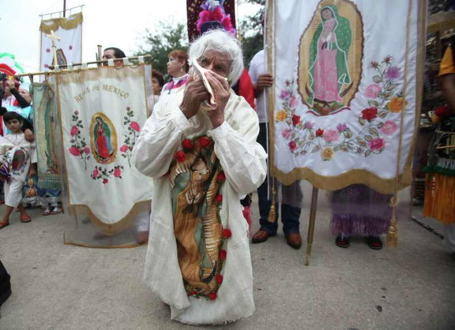Pablo Munoz, 71, of San Juan Diego Catholic Church, uses a sea shell as a musical instrument after a short prayer at the start of Sunday's procession through downtown Houston honoring Our Lady of Guadalupe, Patroness of the Americas. Photo: Mayra Beltran, Houston Chronicle / © 2011 Houston Chronicle