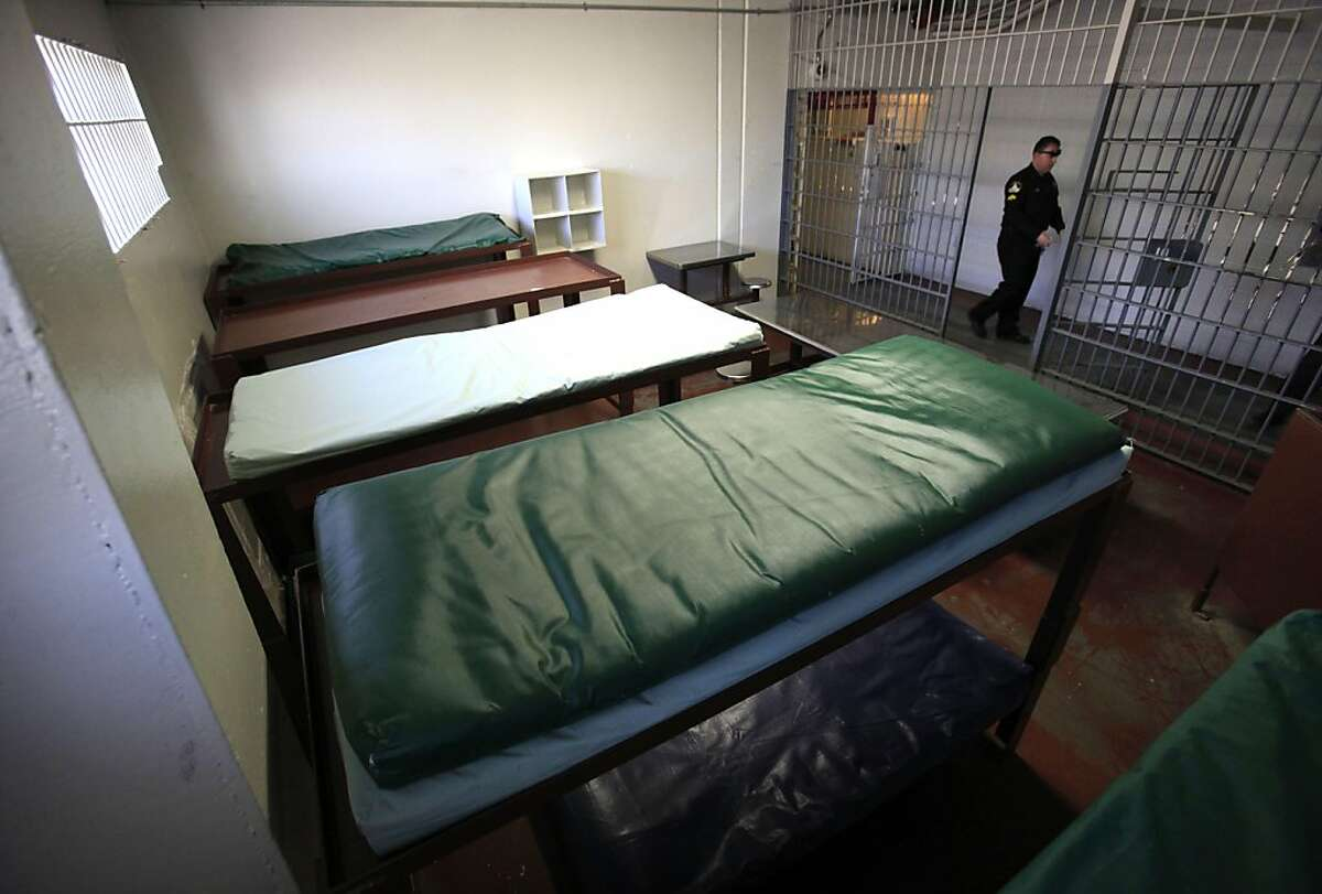 FILE In this Tuesday, Sept. 27, 2011 file photo, double-tiered bunks are seen in one of the cells at a formerly closed housing unit at the Rio Cosumnes Correctional Center, in Elk Grove, Calif. that was reopened to handle the increase of inmates sentenced under the new prison realignment program.