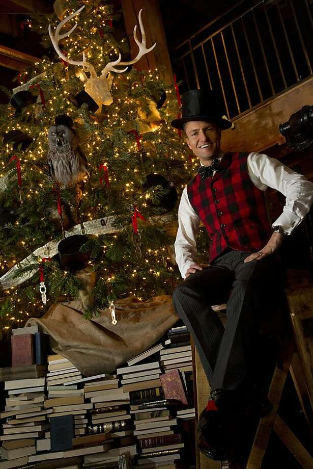 "Designer Ken Fulk, stands next to the ""heads and tails"" themed Christmas tree his design team decorated with top hats, fox tails, key holes and a custom made ribbon, in his San Francisco studio Tuesday, November 15, 2011. Photo: Erin Lubin, Special To The Chronicle"