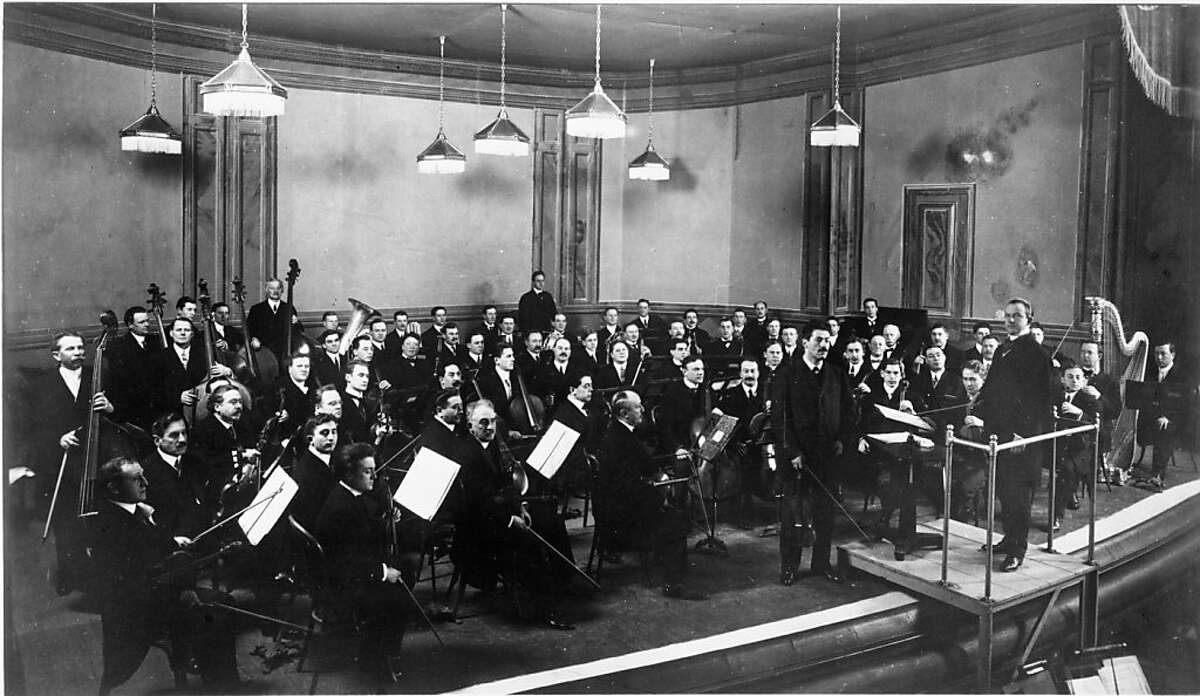 Henry Hadley conducting the San Francisco Symphony Orchestra w/ soloist Fritz Kriesler at the Cort Theatre, San Francisco. 400 people, a mixture of music critics and music lovers, packed the Cort Theatre on December 8, 1911 to attend the Symphony's inaugural concert. San Francisco Chronicle reporter Harvey Wickham sung its praises, writing in a review: