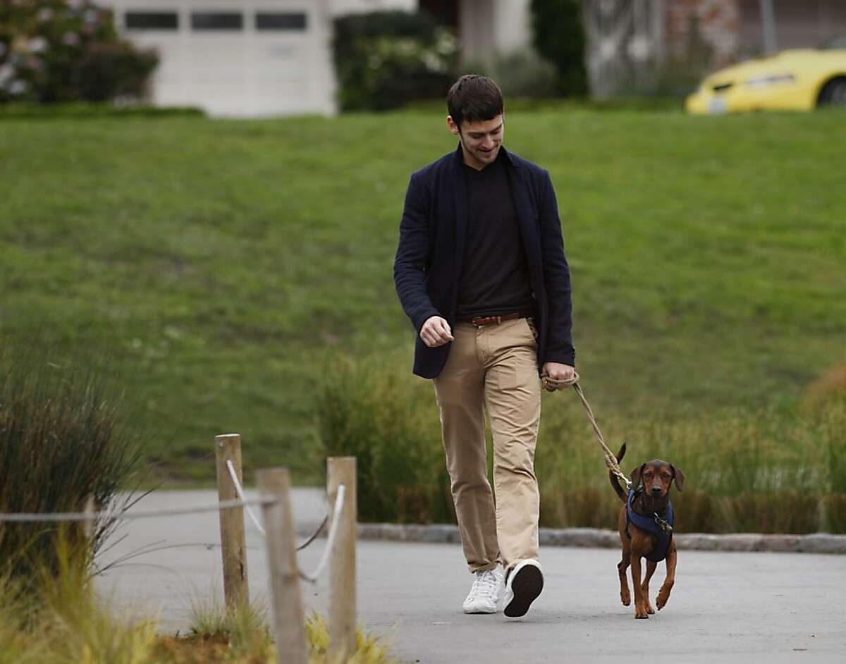 Garen Scribner walks his dog Pilot around the Palace of Fine Arts, Wednesday November 23, 2011, in San Francisco, Calif. Scribner is a member of the San Francisco Ballet and this is his ninth season of in the Nutcracker with the company.