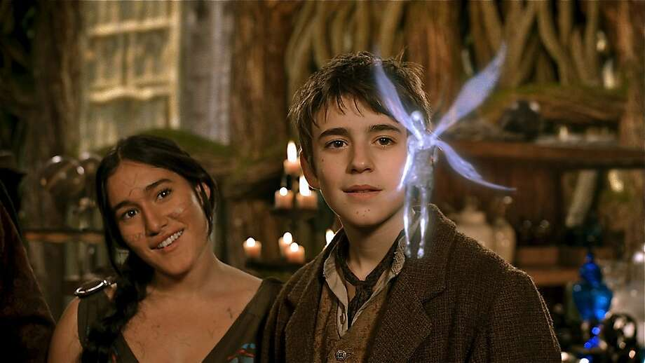 NEVERLAND -- Season: 2011 -- Pictured: (l-r) Q'orianka Kilcher as Aaya, Charlie Rowe as Peter, Tinkerbell -- Photo by: Syfy Photo: Syfy