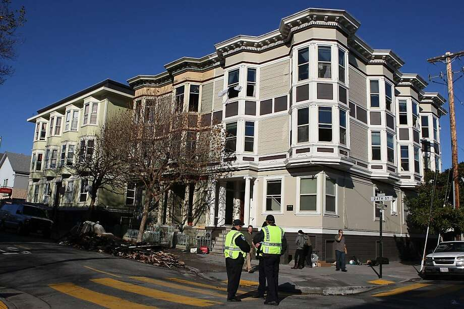 A fire at a building on 24th at Bartlett streets displaced several tenants in San Francisco, Calif., on Thursday, December 1, 2011.  Ran on: 12-02-2011 Two side-by-side apartment buildings on 24th Street near Mission suffered damage. Ran on: 12-02-2011 Two side-by-side apartment buildings on 24th Street near Mission suffered damage in the early morning fire. Tight quarters and whipping wind made for a difficult job for firefighters, the fire chief said. Photo: Liz Hafalia, The Chronicle