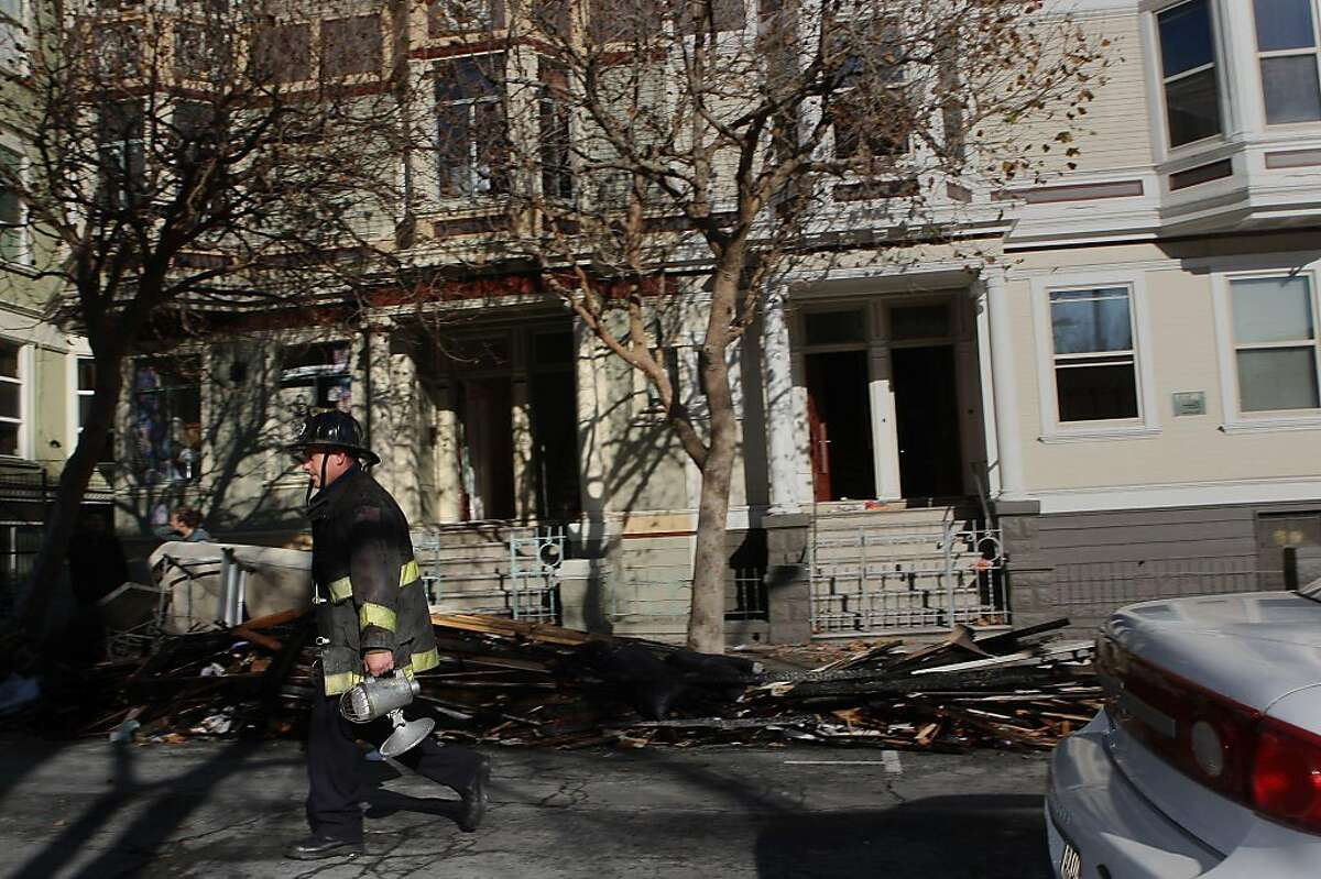 A fire at a building on 24th at Bartlett streets displaced several tenants in San Francisco, Calif., on Thursday, December 1, 2011.
