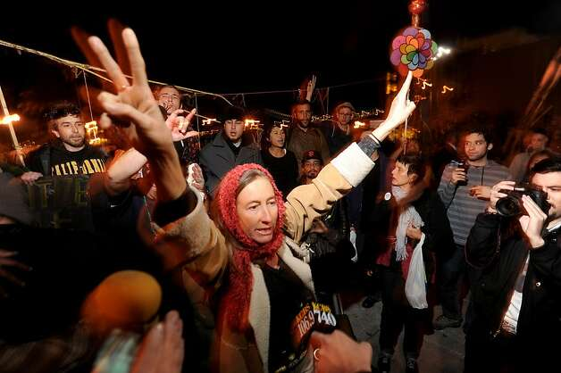 An Occupy SF protester celebrates after fellow demonstrators removed police barricades fronting their camp on Thursday, Dec. 1, 2011, in San Francisco. Officers, who had  installed the barriers several hours early, retreated following the confrontation. Photo: Noah Berger, Special To The Chronicle