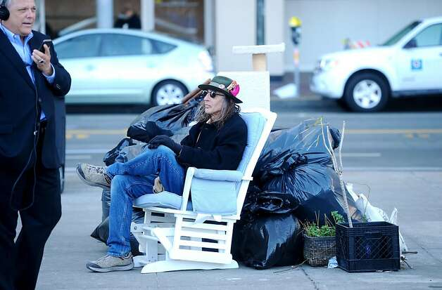 "Anticipating a city raid, Occupy SF protester Jack ""Two Horses"" Martin waits with his belongings for a city truck to take him to what he described as a sanctioned camp location in the Mission district on Thursday, Dec. 1, 2011, in San Francisco. As of late afternoon no truck had arrived. Photo: Noah Berger, Special To The Chronicle"