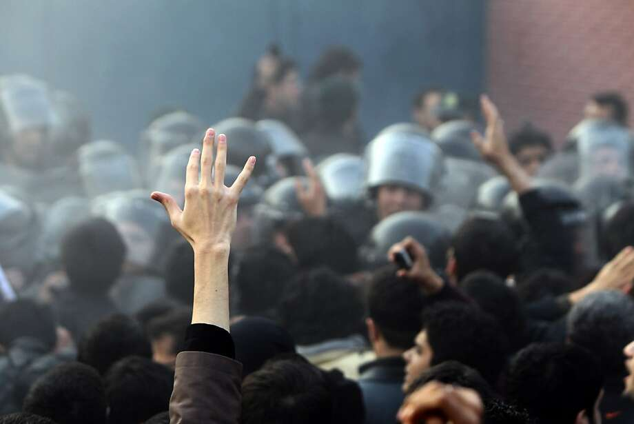 Iranian riot policemen (background) try to prevent hardline protesters from approaching the British Embassy during a protest in Tehran on November 29, 2011. More than 20 Iranian protesters stormed the British embassy in Tehran, removing the mission's flag and ransacking offices. AFP PHOTO/ATTA KENARE (Photo credit should read ATTA KENARE/AFP/Getty Images) Photo: Atta Kenare, AFP/Getty Images