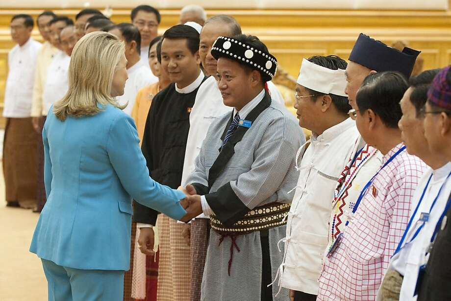 US Secretary of State Hillary Clinton greets members of the Upper House of Myanmar Parliament during a meeting at the Parliamentary Compound in Naypyidaw, Myanmar on December 1, 2011. Clinton is traveling to the country in the first visit by a US Secretary of State in more than 50 years. AFP PHOTO / POOL / Saul LOEB (Photo credit should read SAUL LOEB/AFP/Getty Images) Photo: Saul Loeb, AFP/Getty Images