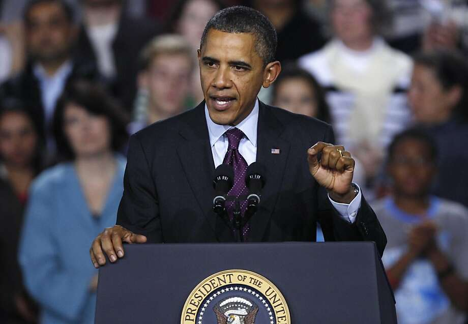 President Barack Obama gestures during an address on the American Jobs Act, Tuesday, Nov. 22, 2011, at Central High School in Manchester, N.H. (AP Photo/Charles Krupa) Ran on: 12-02-2011 President Obama is running ads critical of Romney. Photo: Charles Krupa, AP