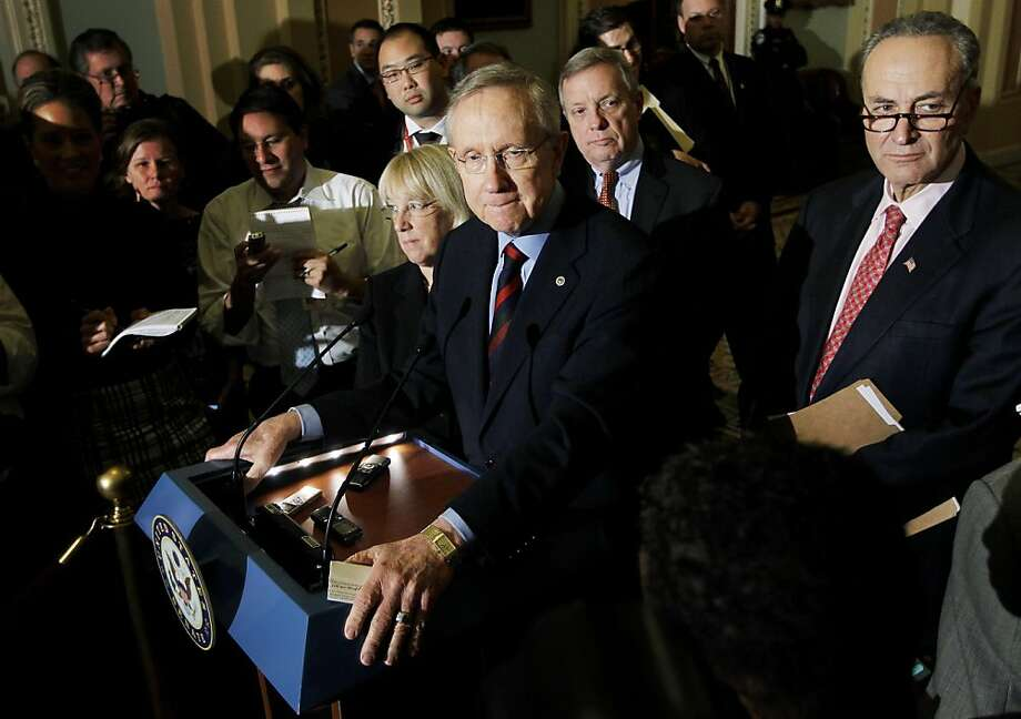 Senate Majority Leader Harry Reid of Nev.,  center, accompanied by Sen. Patty Murray, D-Wash., Senate Majority Whip Richard Durbin of Ill., and Sen. Charles Schumer, D-N.Y., speaks to reporters about extending the payroll tax cut, Thursday, Dec. 1, 2011, on Capitol Hill in Washington. (AP Photo/Charles Dharapak) Ran on: 12-02-2011 Senate Majority Leader Harry Reid (center) discusses the measure surrounded by Sens. Patty Murray, Richard Durbin and Chuck Schumer. Ran on: 12-02-2011 Senate Majority Leader Harry Reid (center) discusses the measure surrounded by Sens. Patty Murray, Richard Durbin and Chuck Schumer. Photo: Charles Dharapak, AP