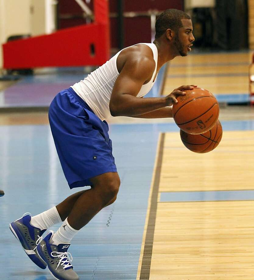 New Orleans Hornets guard Chris Paul works out during a voluntary basketball workout at the team's practice facility in Westwego, La., Thursday, Dec. 1, 2011. Thursday was the first day players could return to team facilities since the NBA lockout began July 1. (AP Photo/Gerald Herbert)  Ran on: 12-02-2011 Chris Paul has more than one ball in his court for his NBA future; his employers hope it remains in New Orleans. Photo: Gerald Herbert, AP