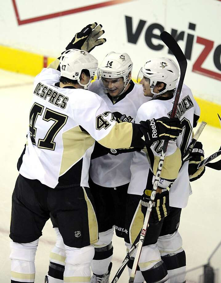 Pittsburgh Penguins left wing Chris Kunitz, center, celebrates his goal with teammates Simon Despres (47) and Matt Niskanen, right, during the third period of an NHL hockey game against the Washington Capitals, Thursday, Dec. 1, 2011, in Washington. The Penguins won 2-1. (AP Photo/Nick Wass) Photo: Nick Wass, AP