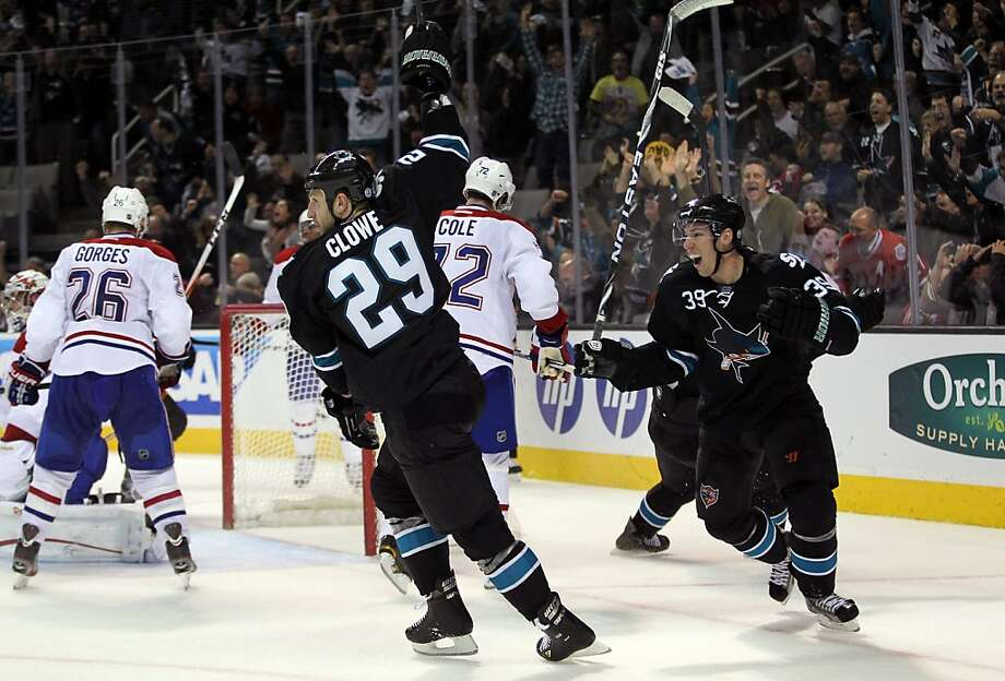SAN JOSE, CA - DECEMBER 01:  Ryane Clowe #29 and Logan Couture #39 of the San Jose Sharks celebrate after Clowe scored the tying goal in the third period of their game against the Montreal Canadiens at HP Pavilion at San Jose on December 1, 2011 in San Jose, California.  (Photo by Ezra Shaw/Getty Images) Photo: Ezra Shaw, Getty Images