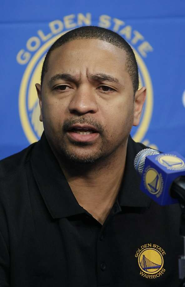 Golden State Warriors head coach Mark Jackson speaks during an NBA basketball news conference in Oakland, Calif., Thursday, Dec. 1, 2011. (AP Photo/Paul Sakuma)  Ran on: 12-02-2011 Mark Jackson visited 49ers practice to get some coaching tips from Jim Harbaugh. Ran on: 12-02-2011 Mark Jackson visited 49ers practice to get some coaching tips from Jim Harbaugh. Photo: Paul Sakuma, AP