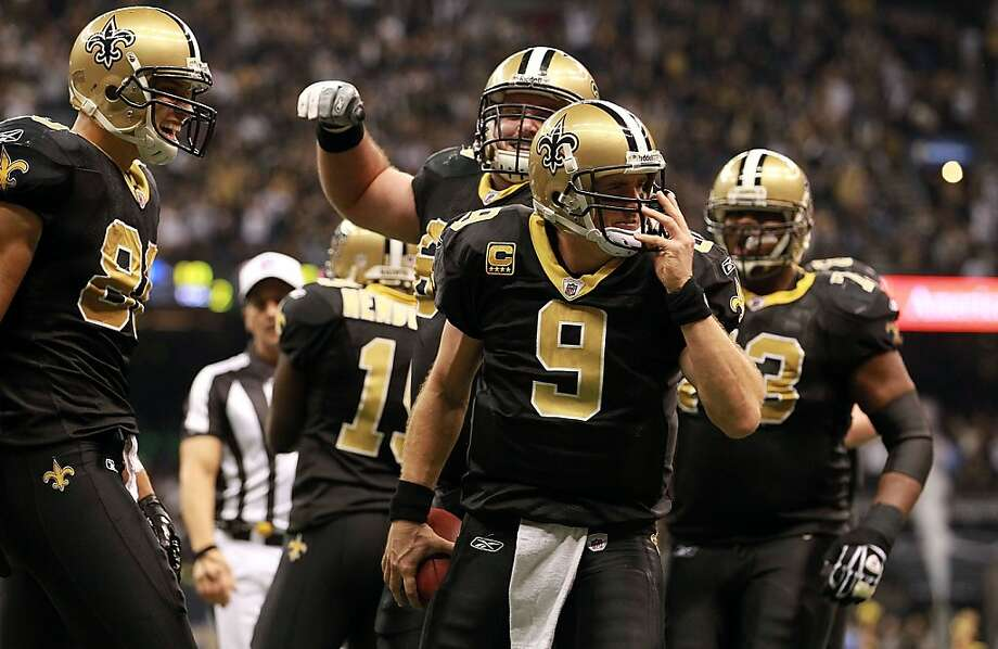 NEW ORLEANS, LA - NOVEMBER 28:  Drew Brees #9 of the New Orleans Saints celebrates his touchdown against the New York Giants at Mercedes-Benz Superdome on November 28, 2011 in New Orleans, Louisiana.  (Photo by Ronald Martinez/Getty Images) Photo: Ronald Martinez, Getty Images