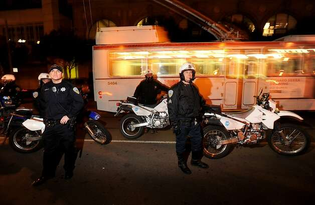 Police officers leave Occupy SF following a confrontation with protesters on Thursday, Dec. 1, 2011, in San Francisco. As officers looked on, demonstrators removed barricades installed a few hours earlier. Photo: Noah Berger, Special To The Chronicle