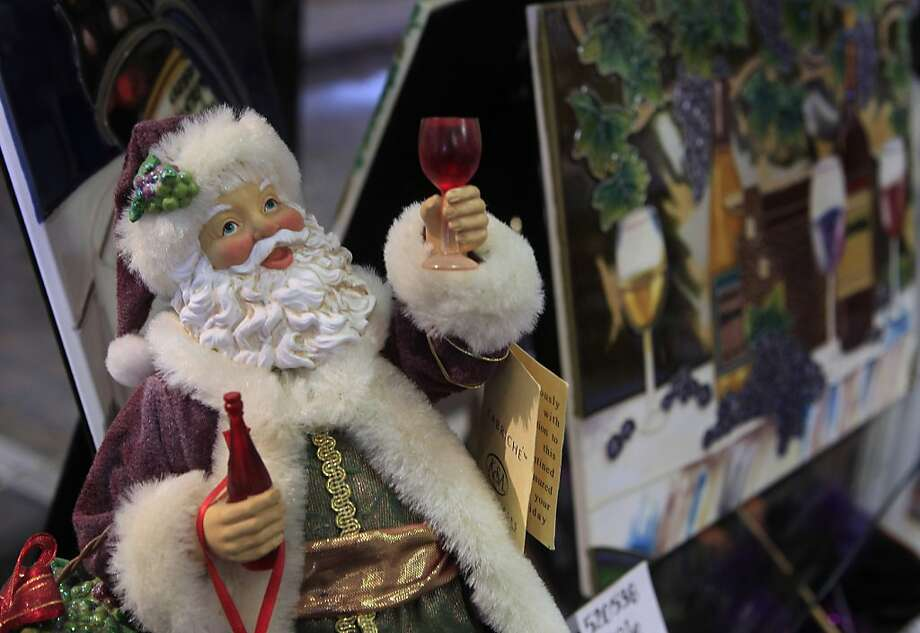 A Santa Claus figurine toasts the holidays at Kris Kringle in Carmel, Calif. on Monday, Nov. 14, 2011. Photo: Paul Chinn, The Chronicle