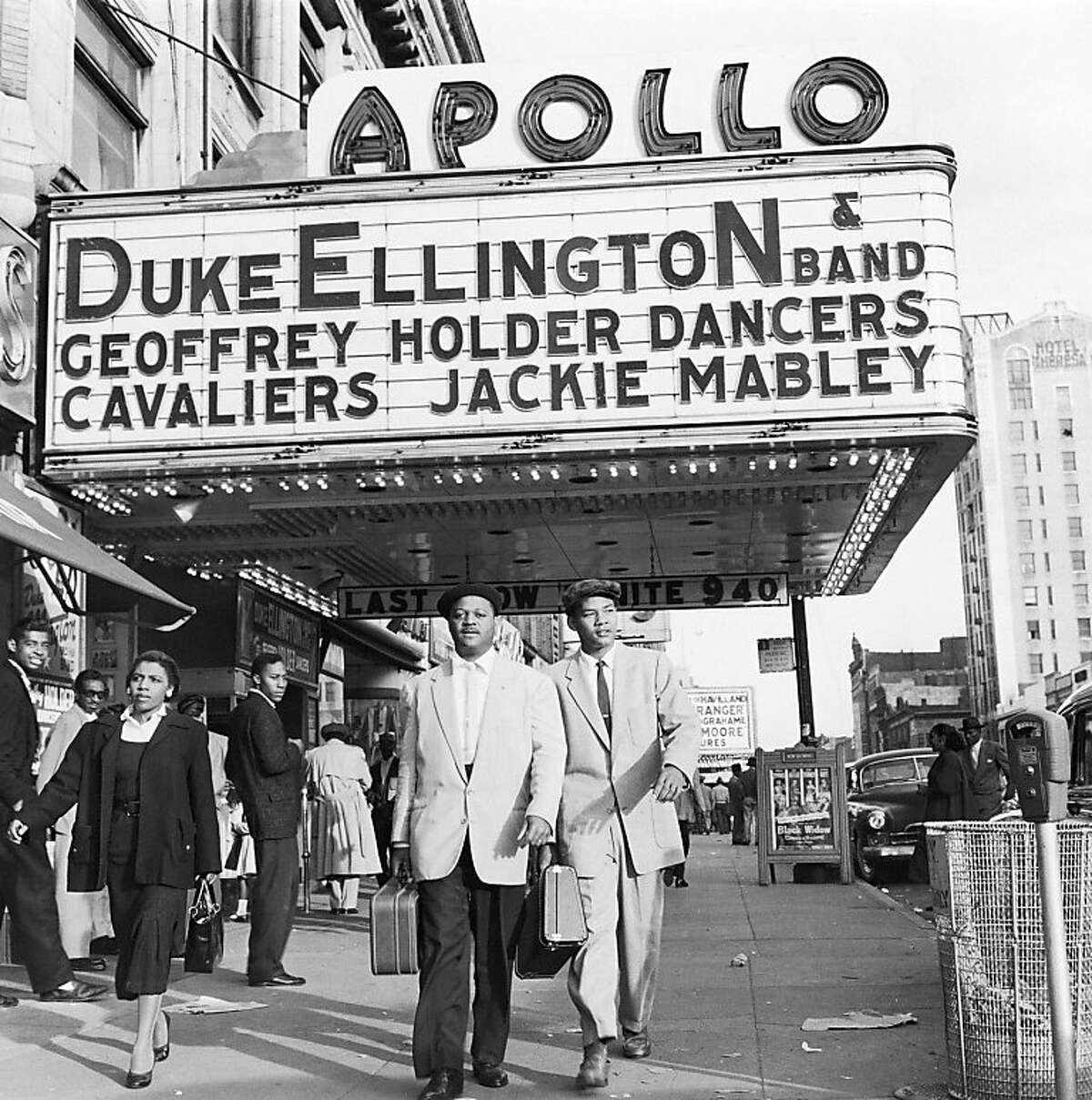 In this 1955 file photo, trumpeter Clark Terry walks with his son Rudolph under the Apollo Theater marquee after Terry's first stage show with Duke Ellington's band in the Harlem neighborhood of New York City. Columbia University and the Apollo Theater Foundation on Thursday, Oct. 23, 2008, announced a joint project to create an oral history of the famed Harlem theater that launched the careers of Ella Fitzgerald, Sarah Vaughan, Smokey Robinson, Stevie Wonder, and other music legends. (AP Photo/G. Marshall Wilson/Ebony Collection, File) ** MANDATORY CREDIT; NO SALES ** Ran on: 10-25-2008 Trumpeter Clark Terry (center left) walks under Apollo marquee.