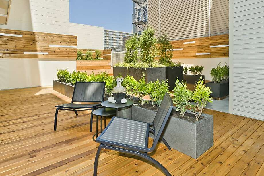 Take in the fresh air and enjoy the outdoors on this spacious sun deck with garden area. Photo: Courtesy Of Vanguard SF
