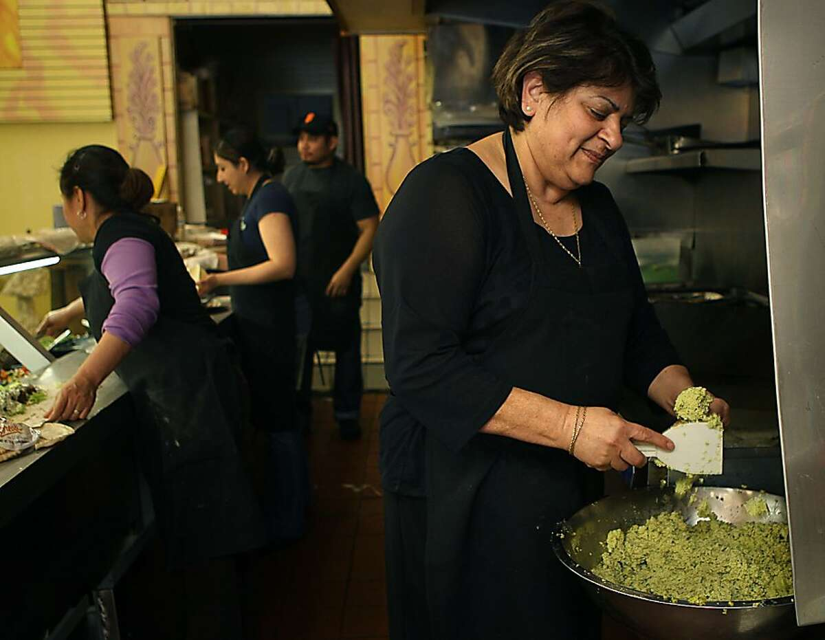 Owner Nawal Kharsa (right) making falafel at King of Falafel on Divisadero Street in San Francisco, Calif., on Thursday, December 1, 2011.