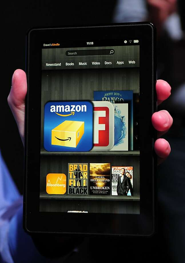 (FILES) This September 28, 2011 file photo shows the new Amazon Kindle Fire tablet displayed at a press conference in New York. Online retailing giant Amazon said November 28, 2011 that sales of its Kindle e-readers and tablets quadrupled on Black Friday over the previous year's annual pre-Christmas national shopping orgy. The company gave no specific data on Kindle sales last Friday, but said its new tablet computer, the Kindle Fire, was also the bestselling product on Amazon.com.     AFP PHOTO/Emmanuel Dunand / FILES (Photo credit should read EMMANUEL DUNAND/AFP/Getty Images) Photo: Emmanuel Dunand, AFP/Getty Images