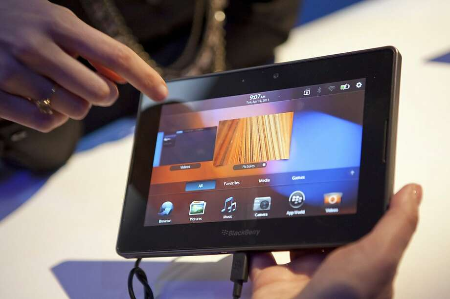 An employee demonstrates the Research In Motion Ltd. BlackBerry PlayBook tablet computer during its unveiling in New York, U.S., on Thursday, April 14, 2011. Research In Motion Ltd. fell in Nasdaq trading after the PlayBook, which goes on sale in the U.S. next week to challenge Apple Inc.'s iPad, received critical first reviews. Photographer: Ramin Talaie/Bloomberg    Ran on: 04-20-2011 BlackBerry's PlayBook has some good qualities, but lacks the apps that help the iPad thrive. Photo: Ramin Talaie, Bloomberg