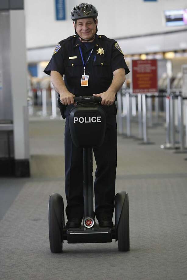 San Francisco police officer, Lt. Tom Buckley tests out a new Segway scooter at the SFO on Monday June 8, 2009 in San Francisco, Calif. Buckley and other SFPD officers at SFO are testing out 5 new Segway scooters as a new possible mode of transportation. Photo: Mike Kepka, The Chronicle