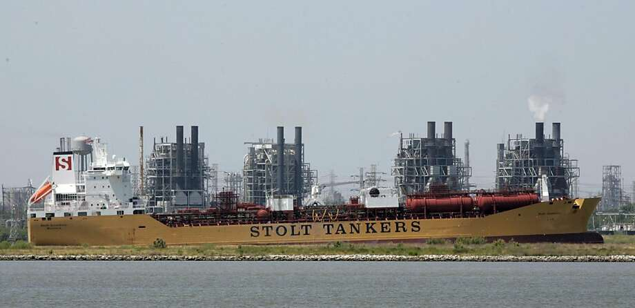 "In this July 14, 2008 file photo, a tanker makes it's way up the Houston Ship Channel near a refinery in Baytown, Texas. The Houston area is a hub for America's oil industry, contributing to the phenomenal growth of America's ""Sun Belt."" (AP Photo/Pat Sullivan, File) Ran on: 06-07-2009 A tanker makes its way to a refinery in the Houston area, a hub for the oil industry. Photo: Pat Sullivan, AP"