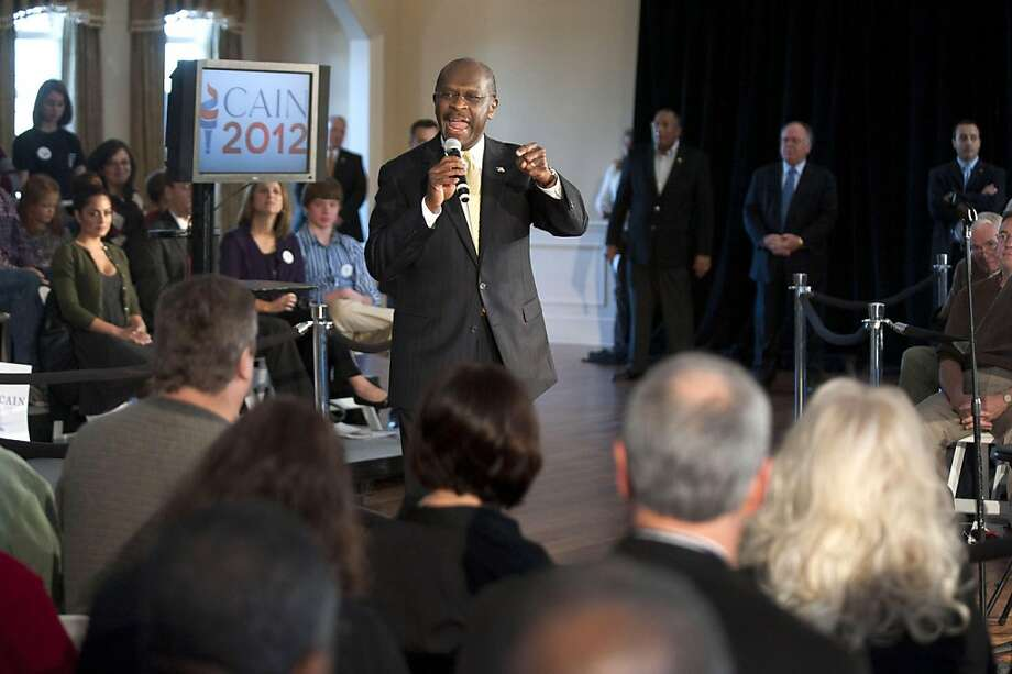ROCK HILL, SC - DECEMBER 2:  Republican presidential candidate Herman Cain speaks to supporters during a town hall meeting at Laurel Ridge on December 2, 2011 in Rock Hill, South Carolina. Cain said he would make an announcement about his campaign in Atlanta tomorrow.  (Photo by Davis Turner/Getty Images) Photo: Davis Turner, Getty Images