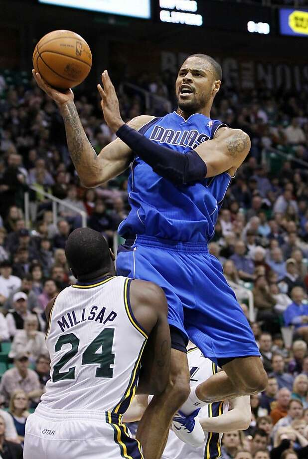 Mavericks center Tyson Chandler, top, attempts to score over Jazz forward Paul Millsap during the first half of an NBA basketball game, Saturday, March 26, 2011, in Salt Lake City. (AP Photo/Colin E Braley)  Ran on: 04-14-2011 Tyson Chandler would give the Warriors a strong inside presence that they lack.  Ran on: 12-03-2011 Chandler Ran on: 12-03-2011 Chandler  Ran on: 12-06-2011 Photo caption Dummy text goes here. Dummy text goes here. Dummy text goes here. Dummy text goes here. Dummy text goes here. Dummy text goes here. Dummy text goes here. Dummy text goes here.###Photo: warriors06_PH21300838400FR123678 AP###Live Caption:Mavericks center Tyson Chandler, top, attempts to score over Jazz forward Paul Millsap during the first half of an NBA basketball game, Saturday, March 26, 2011, in Salt Lake City.###Caption History:Mavericks center Tyson Chandler, top, attempts to score over Jazz forward Paul Millsap during the first half of an NBA basketball game, Saturday, March 26, 2011, in Salt Lake City. (AP Photo-Colin E Braley)____Ran on: 04-14-2011__Tyson Chandler would give the Warriors a strong inside presence that they lack.____Ran on: 12-03-2011__Chandler__Ran on: 12-03-2011__Chandler###Notes:Tyson Chandler, Paul Millsap###Special Instructions: Ran on: 12-06-2011 Photo caption Dummy text goes here. Dummy text goes here. Dummy text goes here. Dummy text goes here. Dummy text goes here. Dummy text goes here. Dummy text goes here. Dummy text goes here.###Photo: warriors06_PH21300838400FR123678 AP###Live Caption:Mavericks center Tyson Chandler, top, attempts to score over Jazz forward Paul Millsap during the first half of an NBA basketball game, Saturday, March 26, 2011, in Salt Lake City.###Caption History:Mavericks center Tyson Chandler, top, attempts to score over Jazz forward Paul Millsap during the first Photo: Colin E Braley, AP