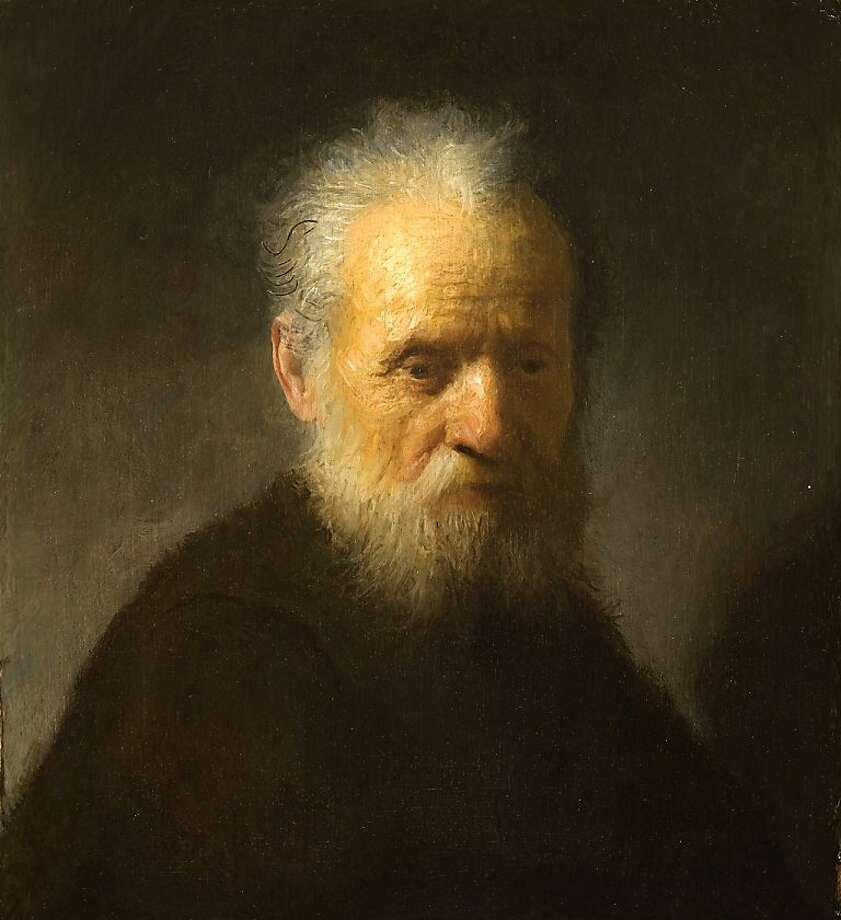 """In this Friday, Dec. 2, 2011 photo provided by the Rembrandt House Museum in Amsterdam, the 1630 painting """"Old Man with Beard"""" by Rembrandt is seen. Ernst van de Wetering of the Rembrandt Research Project says a painting long thought to have been made by one of his students is actually from the hand of the Dutch master himself. Van de Wetering cites new scans of the painting """"Old Man with Beard,"""" in addition to stylistic analysis and circumstantial evidence for the conclusion. The scans revealed an uncompleted self-portrait by Rembrandt underneath. (AP Photo/ Rembrandt House Museum)  Ran on: 12-03-2011 X-ray analysis revealed outlines of a self-portrait underneath the 1630 &quo;Bearded Old Man.&quo; Photo: Rembrandt House Museum, AP"""