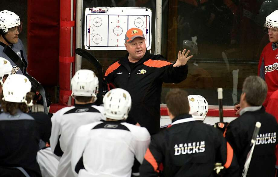 The new Anaheim Ducks new head coach Bruce Boudreau, center, conducts his first practice with the NHL team on Thursday, Dec. 1, 2011, at the Anaheim Rinks facility in Anaheim, Calif. (AP Photo/The Orange County Register, Leonard Ortiz)  LOS ANGELES TIMES OUT; MAGAZINES OUT    Ran on: 12-03-2011 Bruce Boudreau has his first practice with the Ducks on Thursday, three days after his firing by the Caps. Ran on: 12-03-2011 Bruce Boudreau had his first practice with the Ducks on Thursday, three days after his firing by the Caps. Photo: Leonard Ortiz, AP