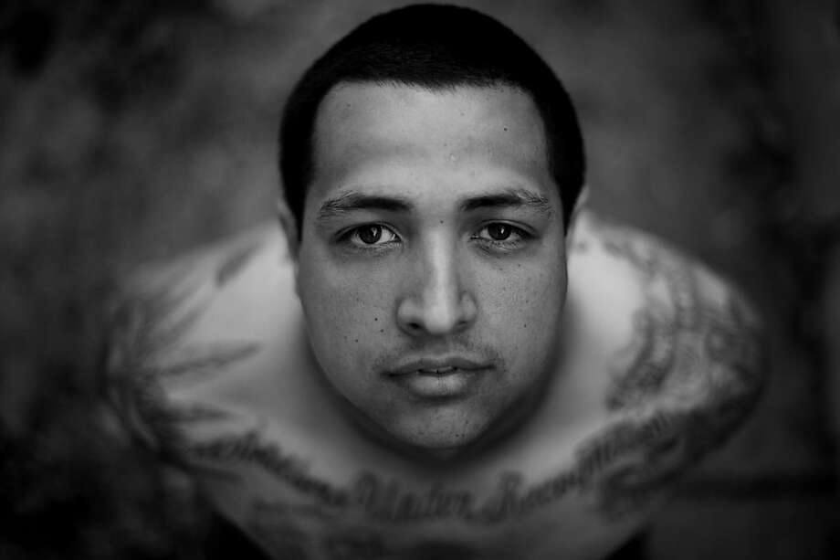 "Former Sure–o gang-member Cris Pulido, 29, showing off a variety of gang-related tattoos at a friendÕs apartment in Rhonert Park, Calif., where he temporally lives. ""I figured IÕm going do this for the rest of my life and theyÕre going to stay on my body forever, no matter how old I get, "" said Pulido who is now in the process of removing all his gang-related tattoos July 7, 2011. Photo: Erik Castro, Special To The Chronicle"