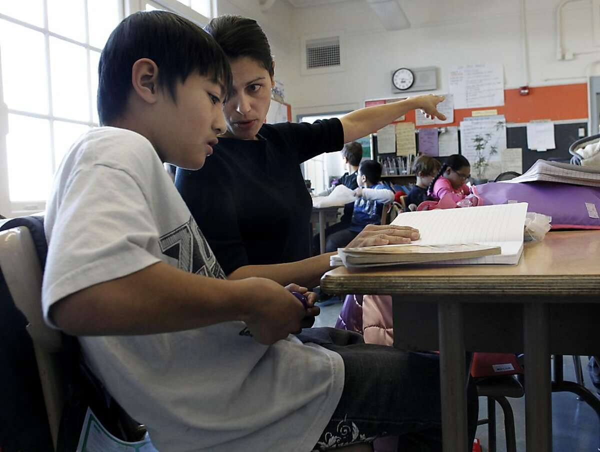 10-year-old Rudy Nguyen works with his fourth grade teacher Jessica Chiarchiaro at Spring Valley Science School. Sophom