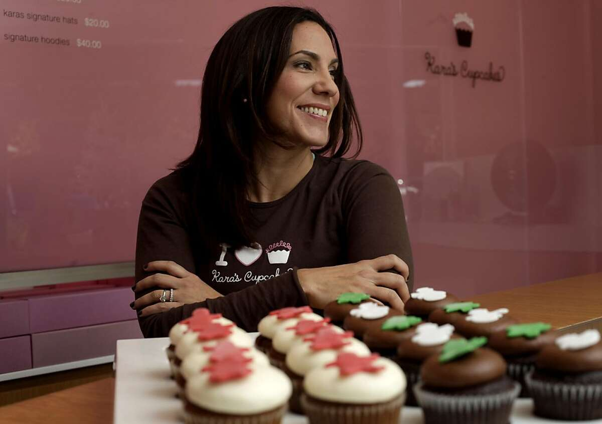 Kara Haspel Lind creator and owner of the Kara's Cupcakes, stands behind the corner of one of her seven stores, Wednesday November 30, 2011, in Palo Alto, Calif.